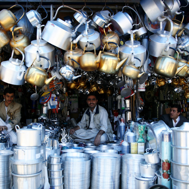 """Shop Keepers Selling Coffee Pot, Huge Kettles And Other Crockery, Sanaa'..."" stock image"
