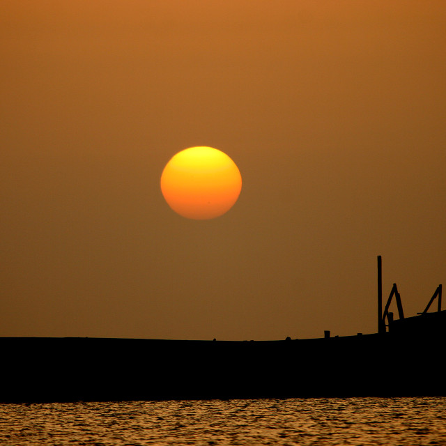 """Amazing Sunset Over A Shadow Dhow, Al Kukhada, Red Sea, Yemen"" stock image"