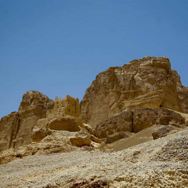 """""""Remains Of A House Merged With The Cliff, Hadramaut, Yemen"""" stock image"""