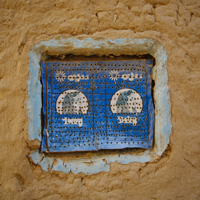 """""""Blue Iron Window Made Out Of A Former Box Of Pure Vegetable Ghee, Yemen"""" stock image"""