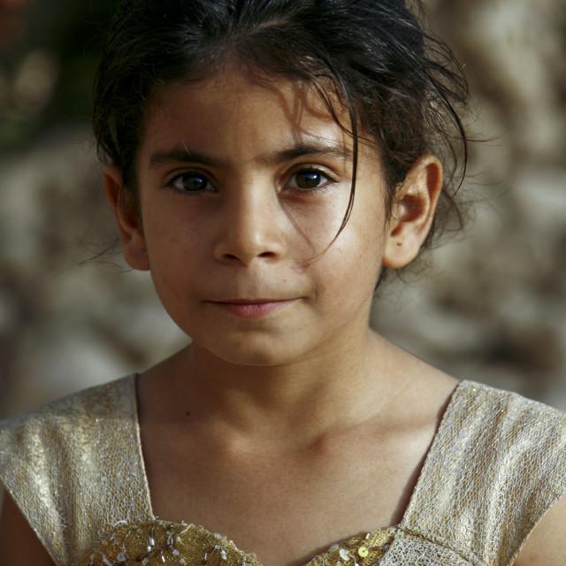"""Portrait Of A Yemeni Girl With Goldy Heart Shaped Dress, Yemen"" stock image"