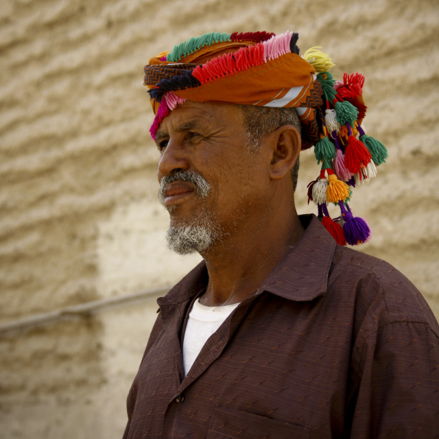 """""""Profile Of An Old Man Wearing A Colourful Turban With Bobbles, Hadramaut, Yemen"""" stock image"""