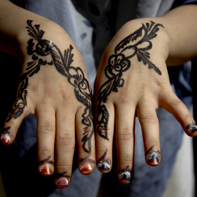 """Floral Designs Drawn With Henna On A Girl Hands, Amran, Yemen"" stock image"