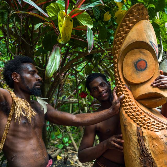 """Tribesmen in front of a slit gong drum, Ambrym island, Fanla, Vanuatu"" stock image"