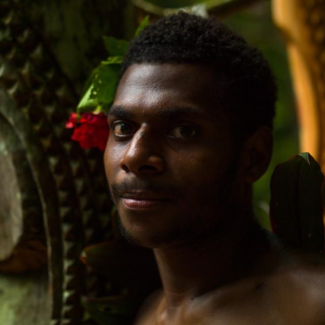 """Tribesman in front of slit drums, Ambrym island, Fanla, Vanuatu"" stock image"