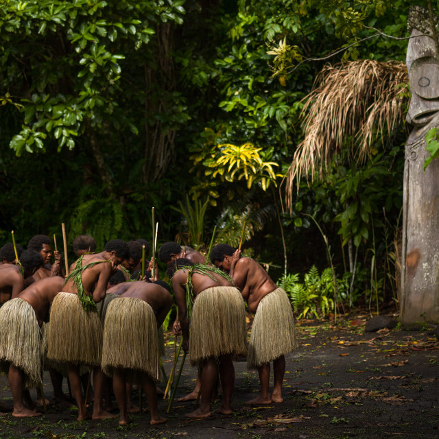 """""""Women with grass skirts performing a Rom dance in front of a giant drum slit,..."""" stock image"""