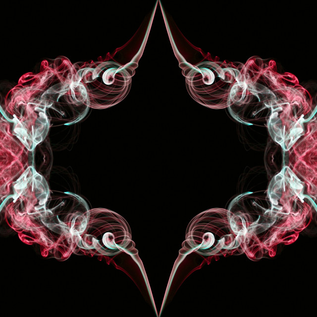 """Red and white abstract twisted smoke isolated on black background, formed in circles and rosettes"" stock image"
