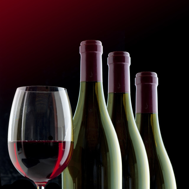"""glass of wine and wine bottles"" stock image"