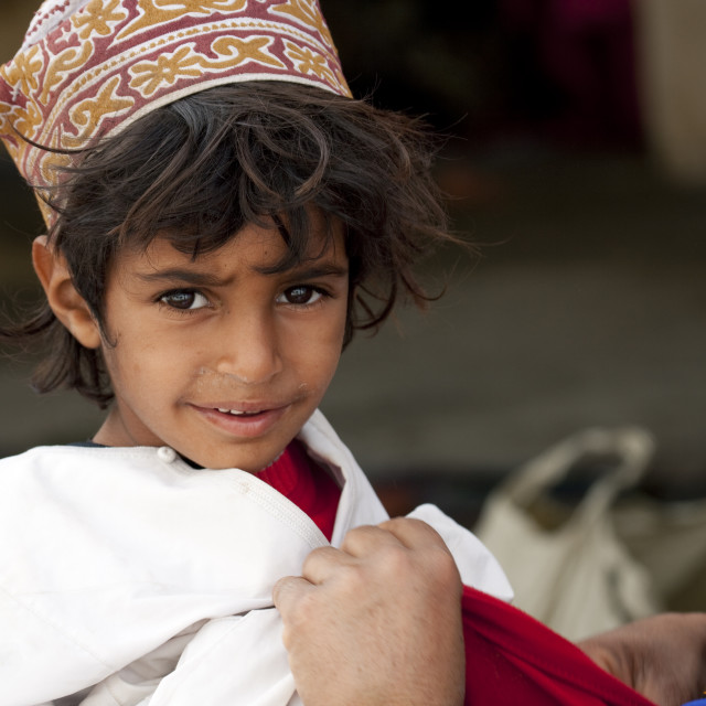 """Bedouin Boy Wearing Colorful Cap, Sinaw, Oman"" stock image"