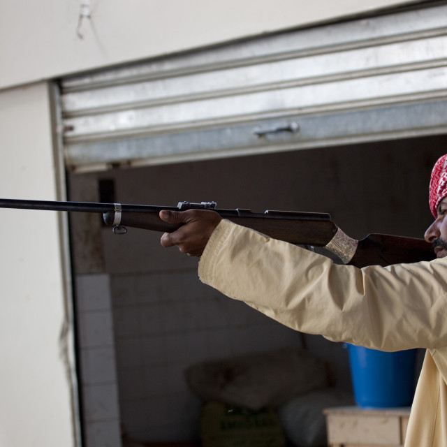 """Man Testing A Gun In The Weapons Souk, Sinaw, Oman"" stock image"