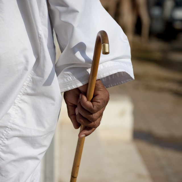 """Man Holding A Wooden Walking Stick, Sinaw, Oman"" stock image"