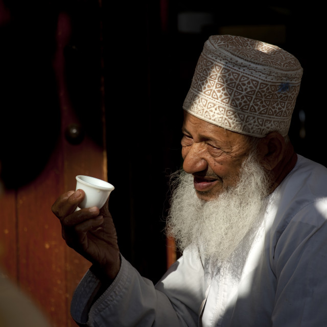 """Old Omani Man In Nishdasha Holding A Cup, Oman"" stock image"