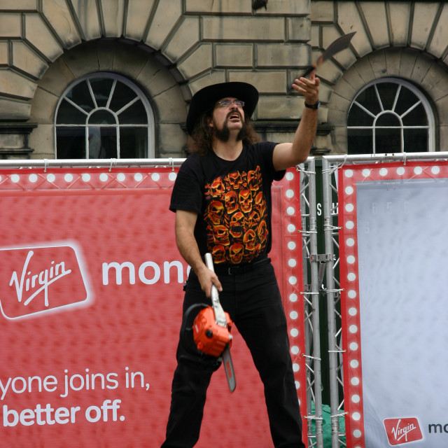 """Street entertainer juggling"" stock image"