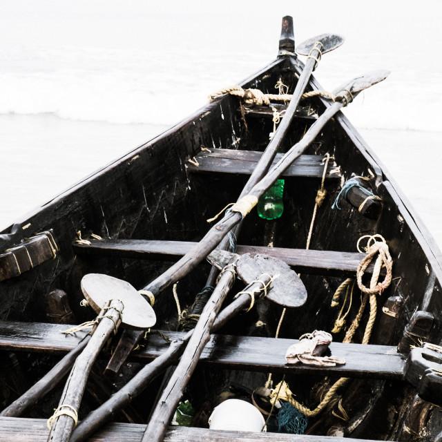 """Fishing boat and paddles - India"" stock image"