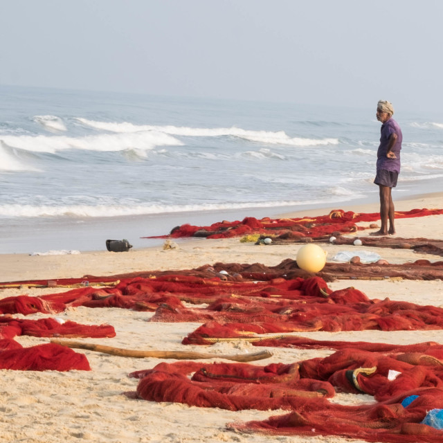 """""""Lone fisherman on the beach with his nets - India"""" stock image"""