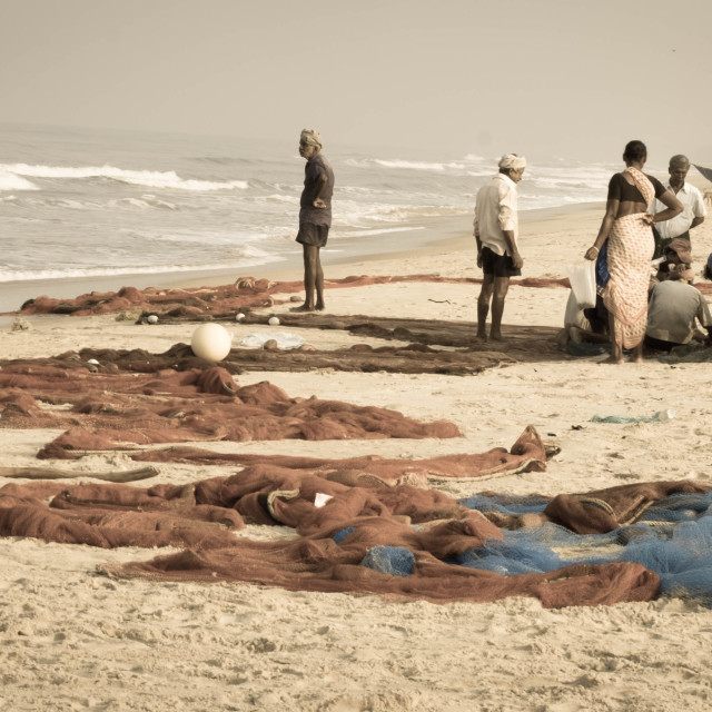 """""""Fisherfolk and their nets on the beach - India"""" stock image"""
