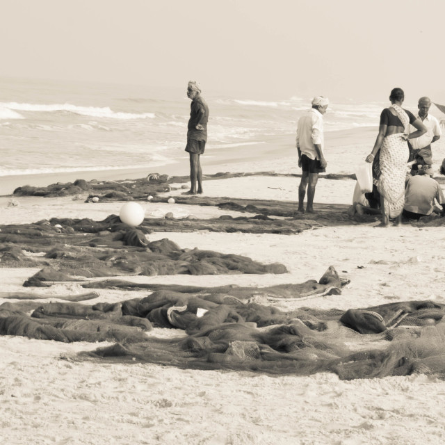 """""""Fisherfolk and their nets on the beach - India b/w"""" stock image"""