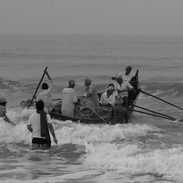 """Launching the boat - fishermen in India b/w"" stock image"