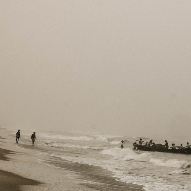 """Fishermen setting nets off the beach - India"" stock image"