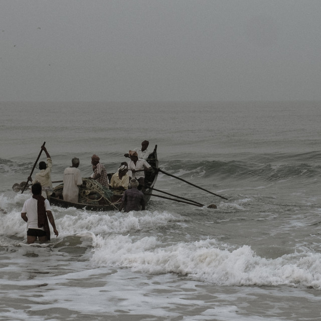 """""""Launching the boat - fishermen in India"""" stock image"""