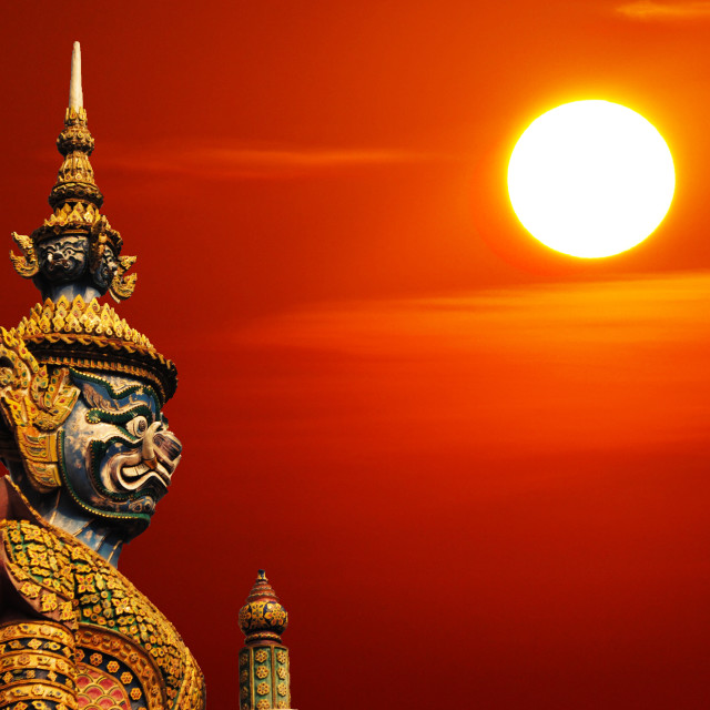 """Statue of demon guardian statue in Thailand with Sun and copyspa"" stock image"