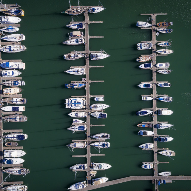 """Aerial view of sail boats docked in a Marina in Portimao, Algarve; Concept for travel in Portugal and luxury summer vacations"" stock image"