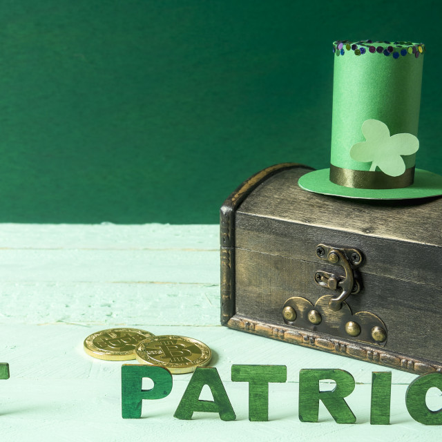 """St Patrick words and hat on a treasure chest"" stock image"
