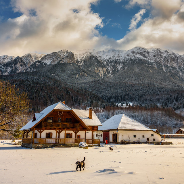 """""""House by the mountains, winter time"""" stock image"""