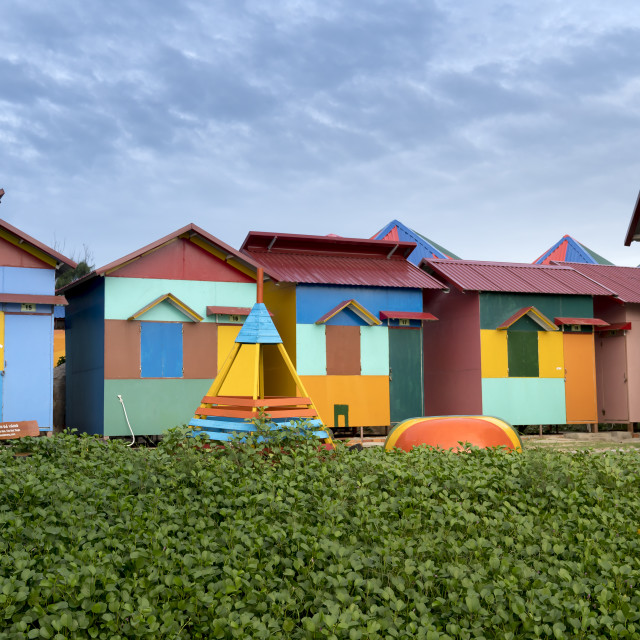 """""""colorful log cabins in a tourist resort located next to the beach in Ke Ga village, Binh Thuan province, Vietnam"""" stock image"""