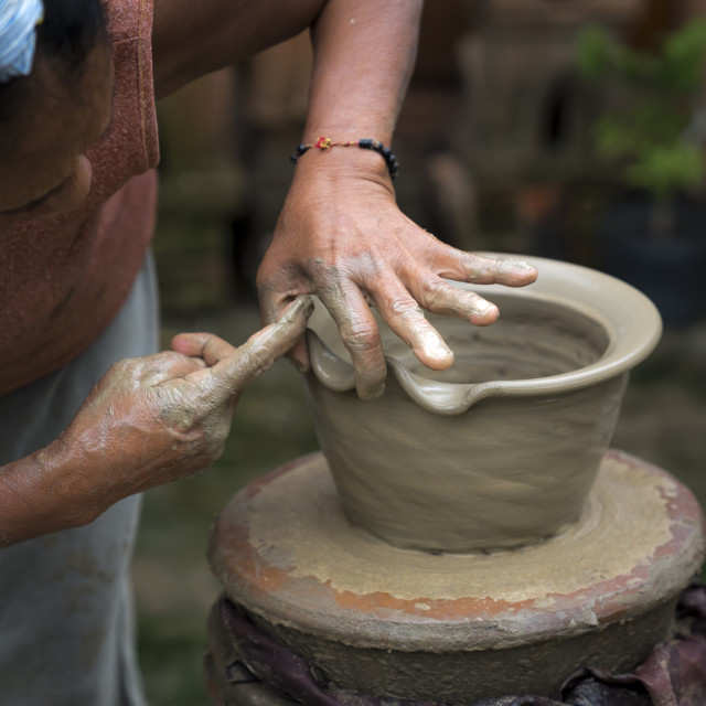 """hands of a pottery artist create traditional handicraft clay vase in Bau Truc pottery village."" stock image"