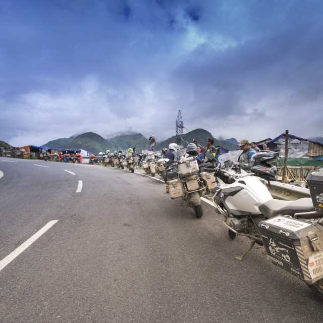 """A powerful moto tour group of Thai Lan are resting and enjoying the beautiful scenery on the O Quy Ho Pass in Lao Cai Province"" stock image"