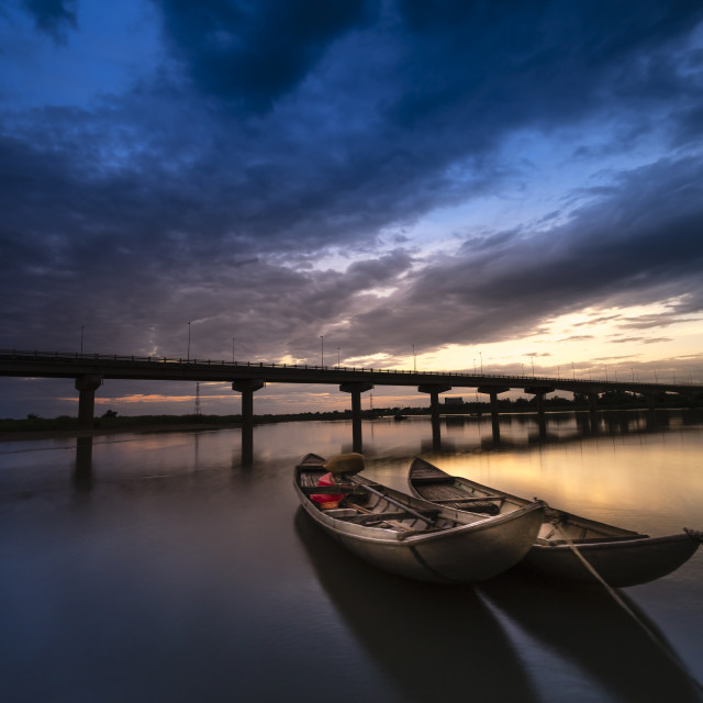 """Small boats in the sunset"" stock image"