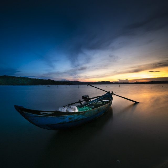 """Small boat lonely in the sunset"" stock image"