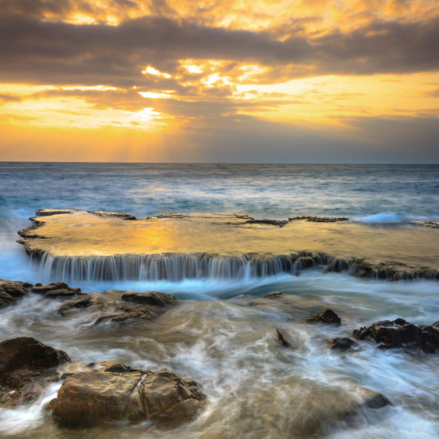 """Amazing landscape when the waves on a large rock and make an waterfall"" stock image"