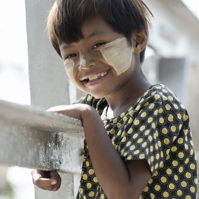 """""""Smiling Birmese girl with traditional Tanaka face paint. Februar"""" stock image"""