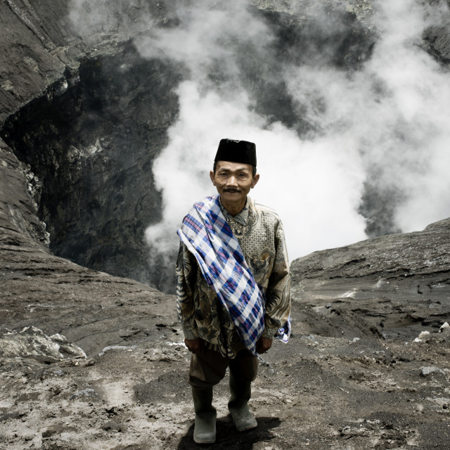 """Tenggerese man standing on the edge of an active volcano Bromo"" stock image"