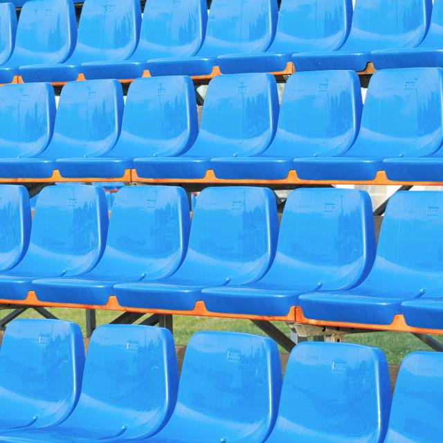 """Blue Plastic Seats"" stock image"