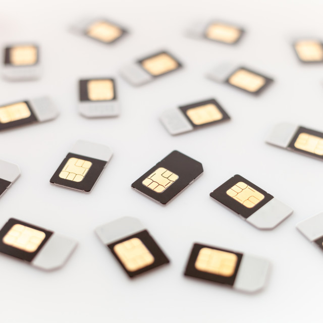 """Sim cards on white background"" stock image"
