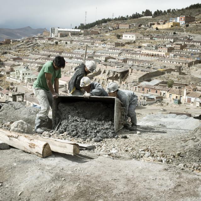 """Miners emptying mine cart at Cerro Rico silver mine in Potosi"" stock image"