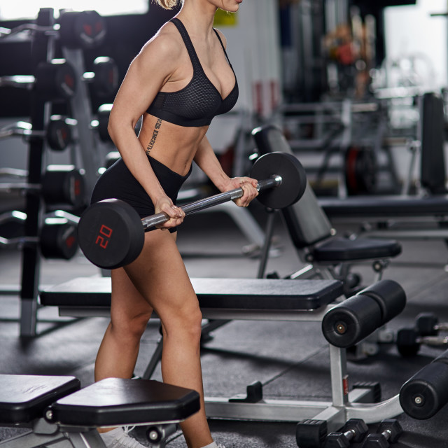 """""""Young woman doing biceps curl"""" stock image"""