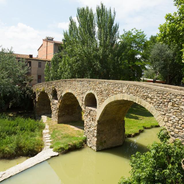 """Old bridge over river in Vic"" stock image"