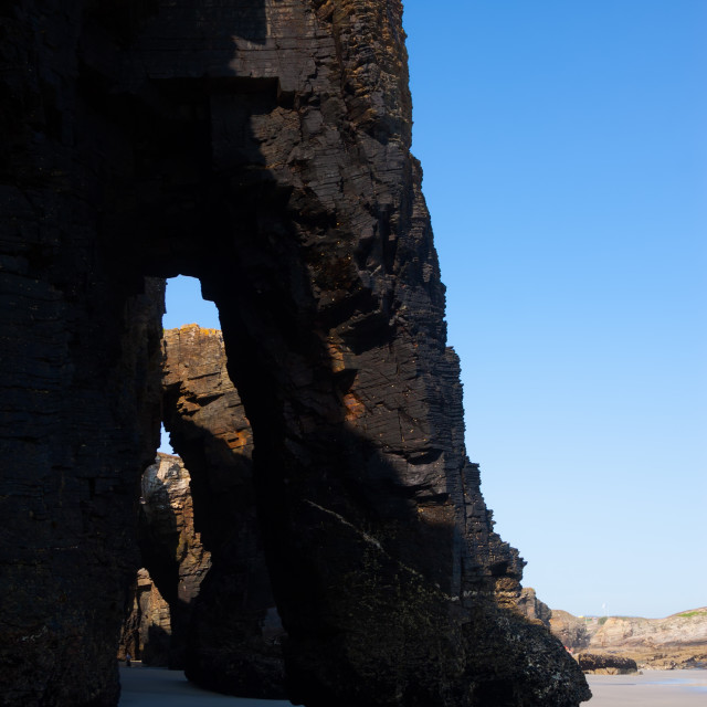 """Natural arch at beach"" stock image"