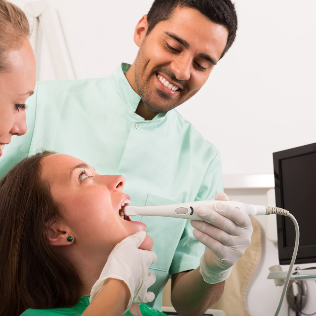 """Patient is examined at dental clinic"" stock image"