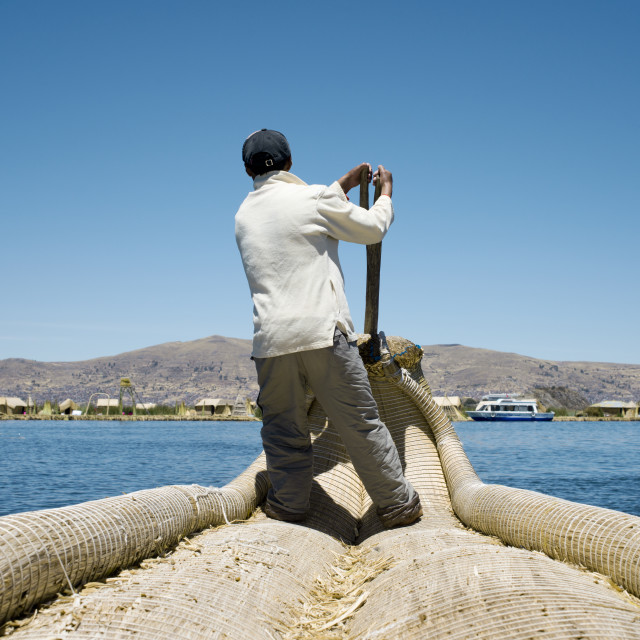"""Reed Boatman of Lake Titicaca, Uros Islands, Peru"" stock image"