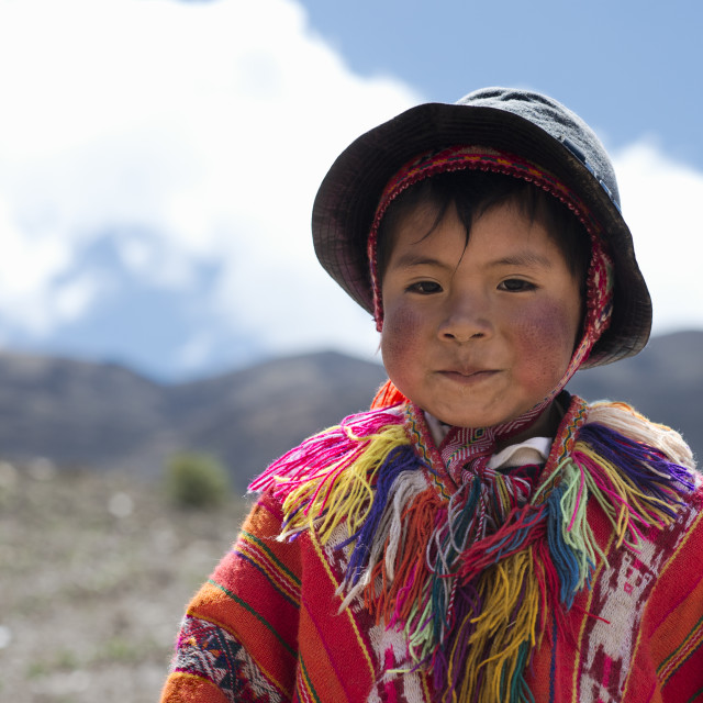 """""""Portrait of a Peruvian boy dressed in colourful traditional handmade outfit"""" stock image"""