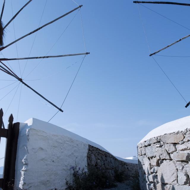 """Windmills with blue sky in Mykonos Island, Cyclades, Greece"" stock image"