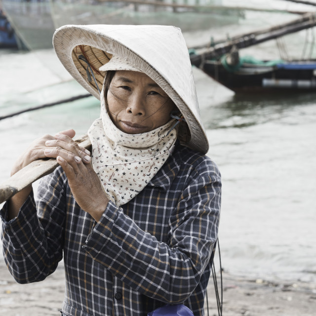 """Vietnamese woman wearing traditional conical hat"" stock image"