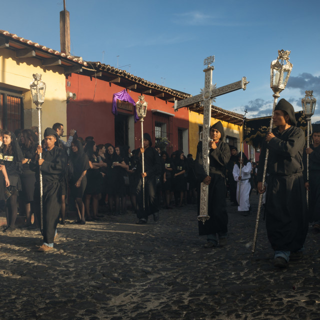 """Antigua, Guatemala - April 19, 2014: Man wearing black robes and hoods in a street of the old city of Antigua during a procession of the Holy Week in Antigua, Guatemala"" stock image"