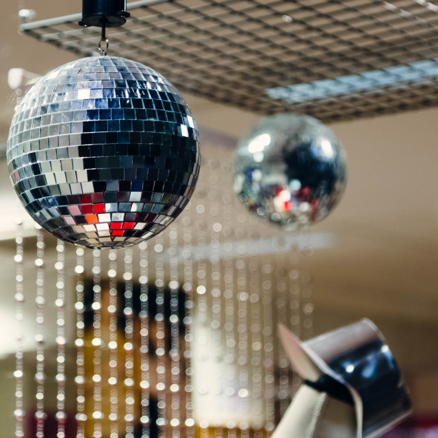 """Shining disco ball on a store window"" stock image"