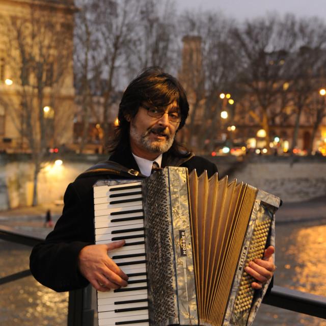 """Parisian accordioniste"" stock image"